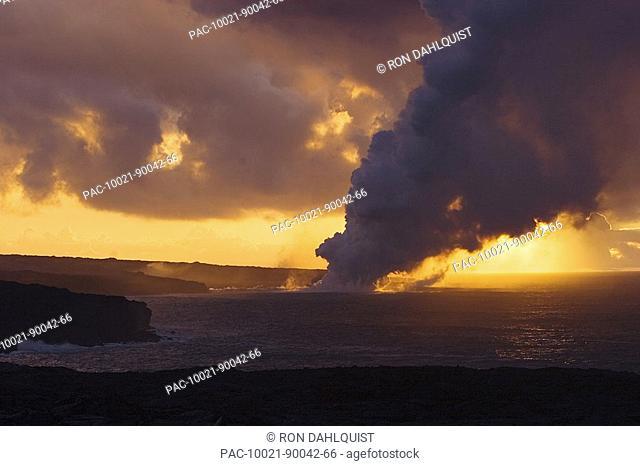 Hawaii, Big Island, Kalapana, Steam cloud from lava entering Pacific Ocean from Kilauea at sunset