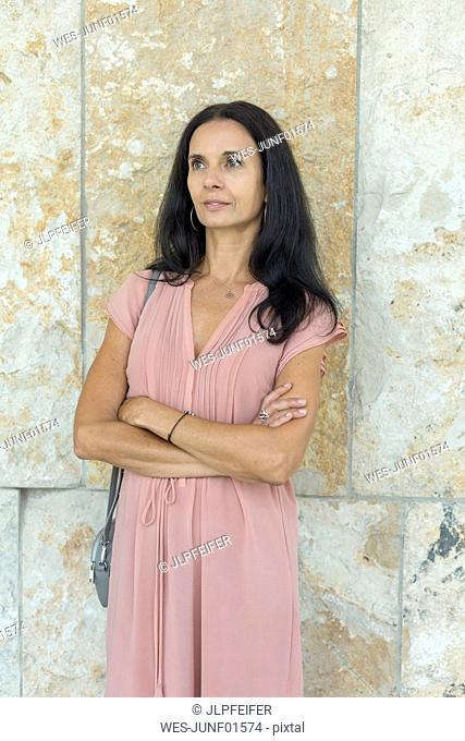 Portrait of mature woman wearing pink summer dress