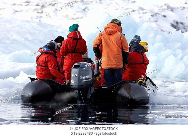 antarctic expedition zodiac boat driving through brash pack sea ice cierva cove antarctica
