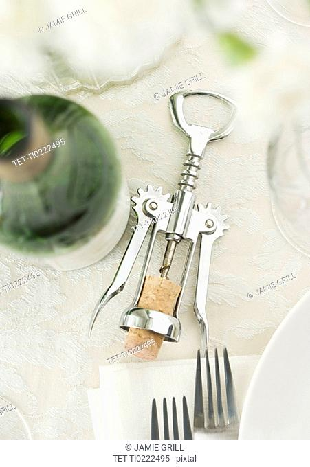 Table setting with wine and corkscrew