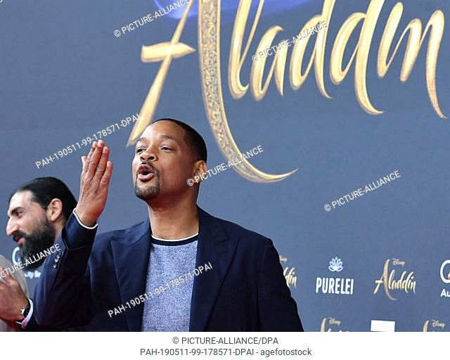 """11 May 2019, Germany (German), Berlin: Actor Will Smith comes to the German premiere of the new Disney film """"""""Aladin"""""""". In the background is actor Numan Acar"""
