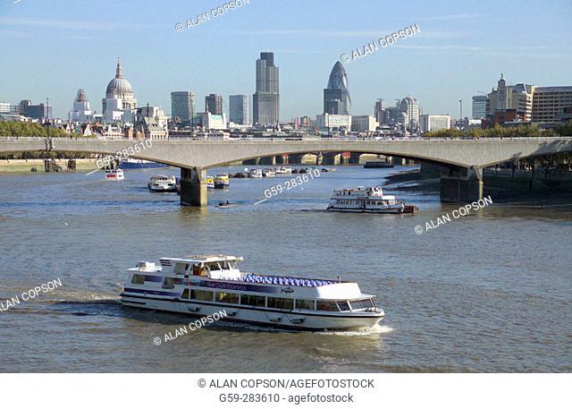 City skyline and Waterloo Bridge over Thames River. London. England