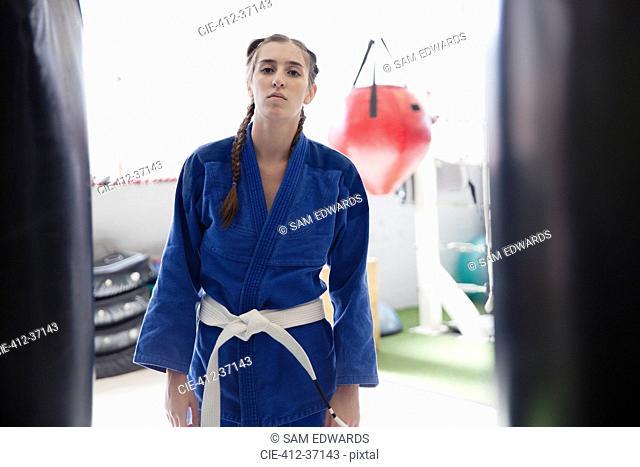 Portrait confident, tough young woman wearing judo uniform