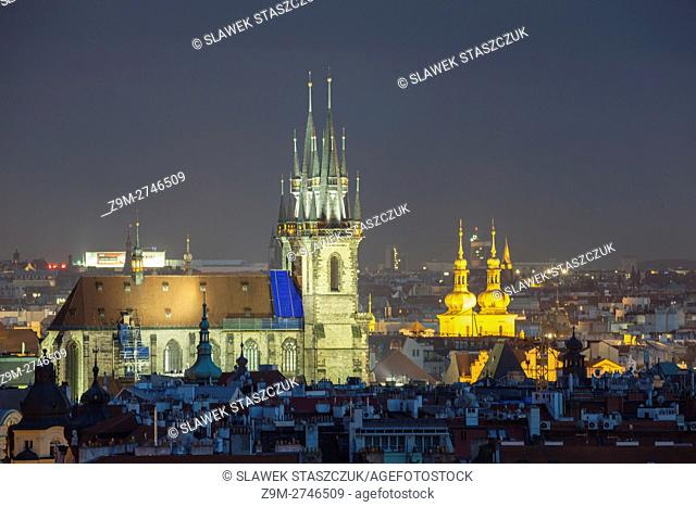 Night falls over Prague old town, Czech Republic. Our lady before Tyn church dominates the skyline