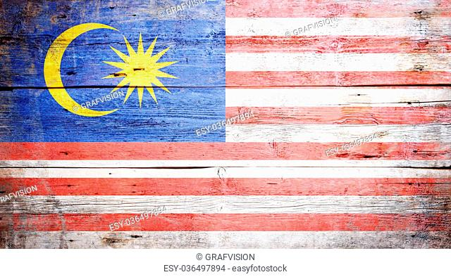 Flag of Malaysia painted on grungy wood plank background