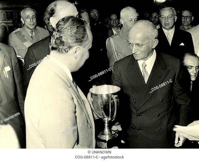 The President of the Italian Republic , Luigi Einaudi receives a cup