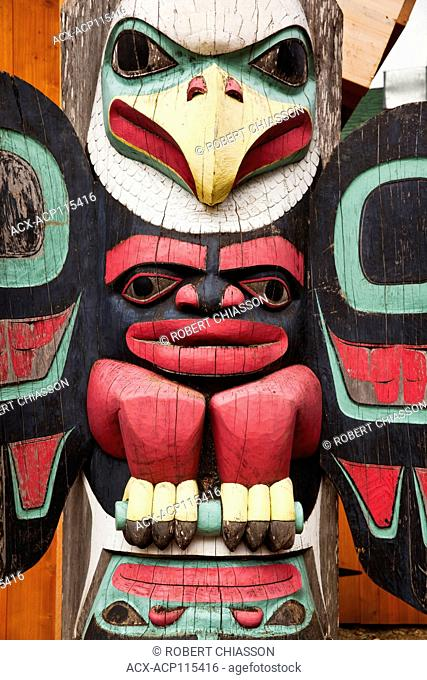 Detail of a colorful Tlinglit totem that frames front entrance of the welcome center (a.k.a. Adventure Center) at Icy Strait Point, Alaska, U.S.A