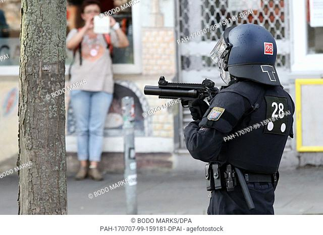 Apolicemen holds a grenade pistol for tear gas in Hamburg, Germany, 7 July 2017. The heads of the governments of the G20 group of countries are meeting in...