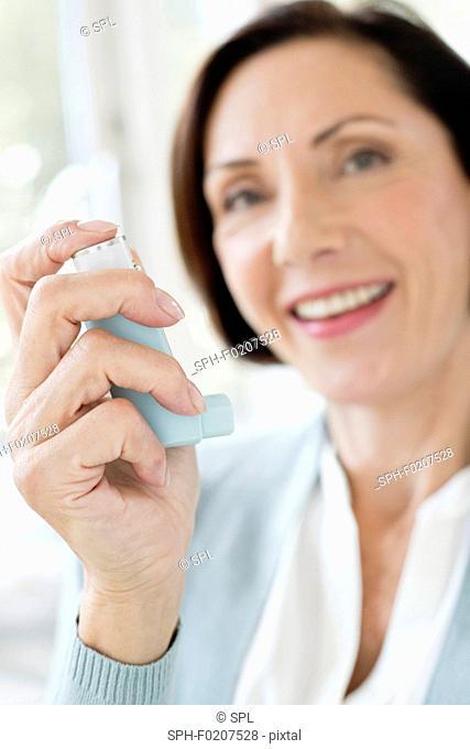 Mature woman using inhaler