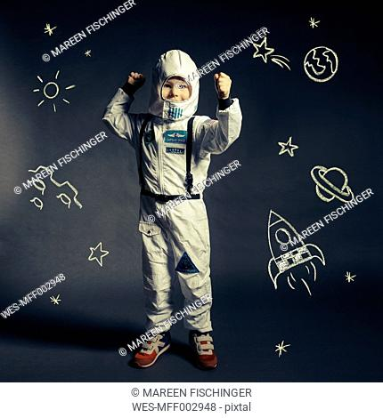 Child with spacesuit orbited by celestial bodies and luminaries