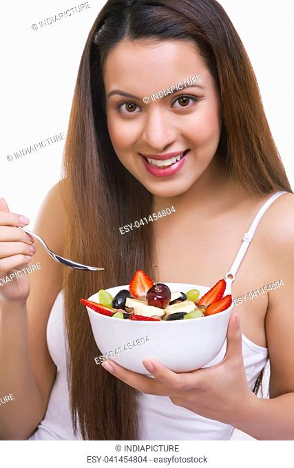 Portrait of woman with a bowl of cereal