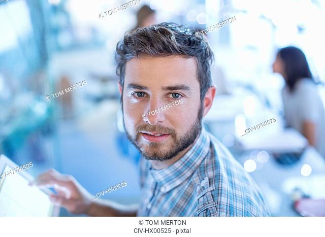Portrait confident businessman with digital tablet