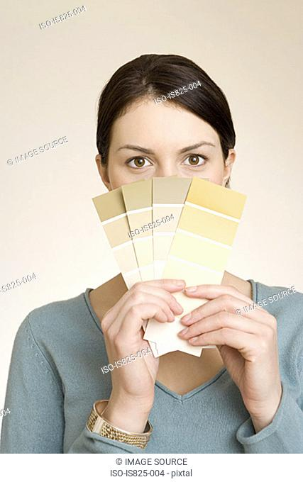 Woman with colour charts