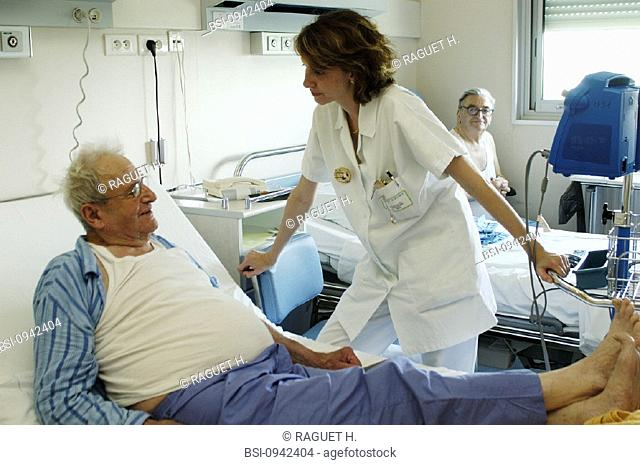 ELDERLY HOSP. PATIENT WITH NURSE<BR>Photo essay from hospital. Patient and nurse.<BR>Hospital of Reims, in the French region of Champagne-Ardenne