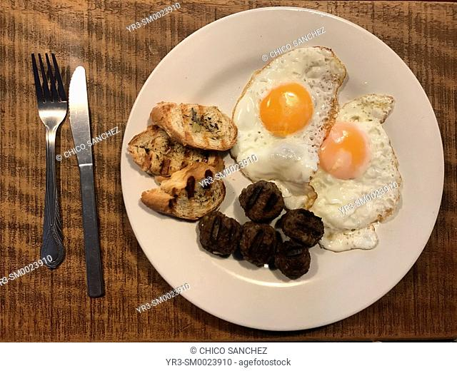 Toasted bread, two fried eggs and meatballs in Fika Swedish restaurant in Colonia Roma, Mexico City, Mexico