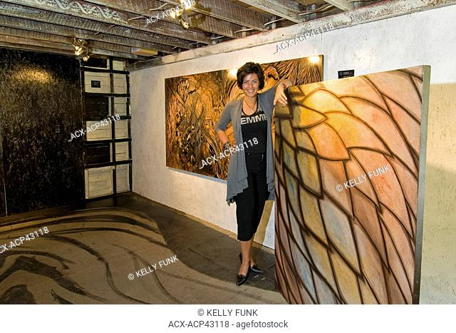 An artist shows her work near Gibsons, British Columbia, Vancouver Coast and mountain region, Canada