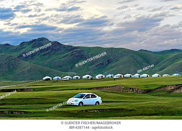 Hilly green countryside, jurts, nomad camp in Orkhon Valley, Mongolia