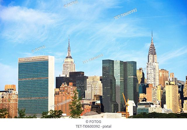 New York City skyline under blue sky