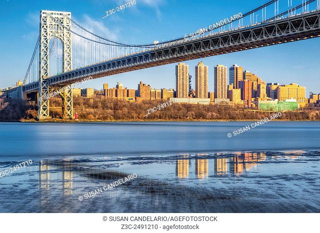 George Washington Bridge NYC Reflections - Wide view of the George Washington Bridge with the New York City skyline during low tide at the Hudson River
