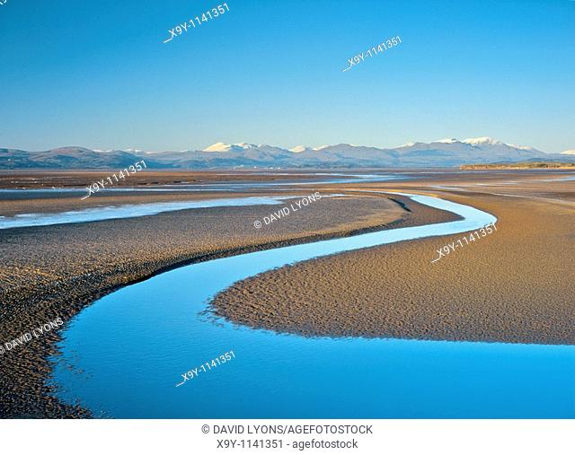 River Duddon flows S  into tidal Duddon Sands, north end of Morecambe Bay, Cumbria, England  Lake District mountains in distance