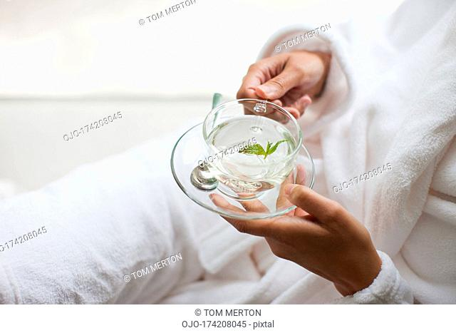 Close up of woman holding water