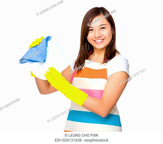 Asian Housewife wash the dish