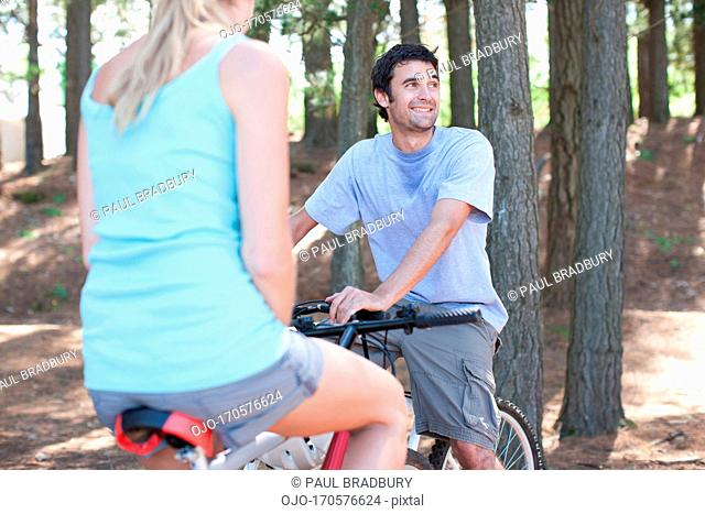 Couple bicycle riding in remote area