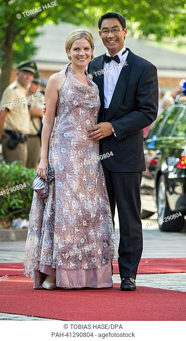 German Vice-Chancellor Philipp Roesler (FDP) and his wife Wiebke arrive at the opening of the Bayreuth Festival 2013 in Bayreuth, Germany, 25 July 2013