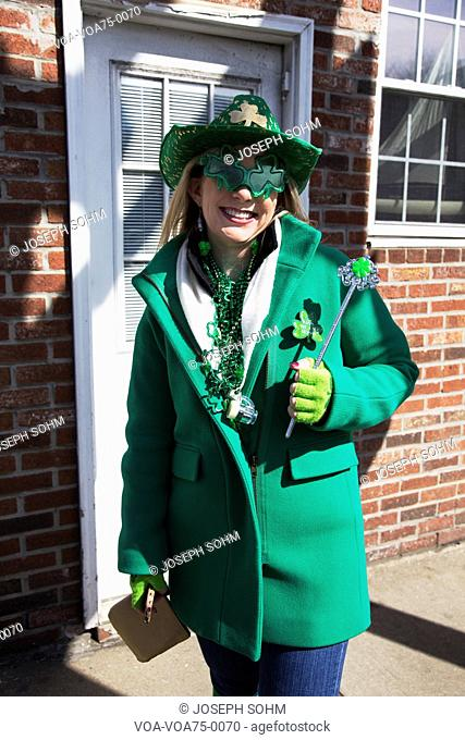 Young woman in green, St. Patrick's Day Parade, 2014, South Boston, Massachusetts, USA