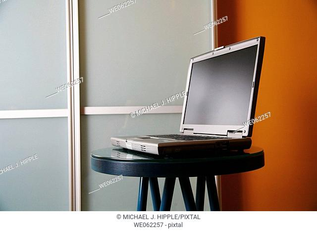 Laptop computer on small table