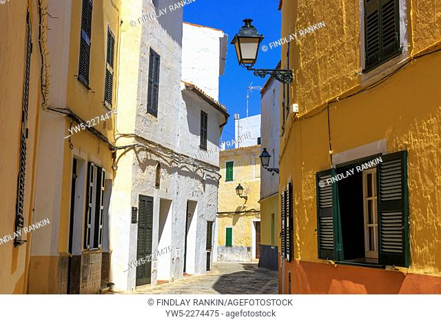 Narrow cobbled lane in the old traditional city of Ciutadella, Menorca, Spain