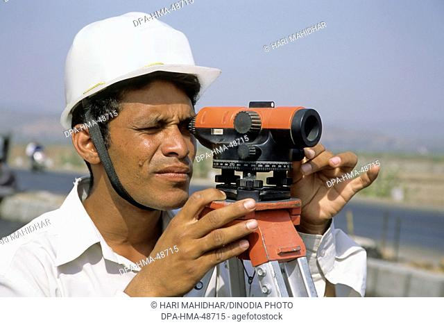 engineer at road construction site , india