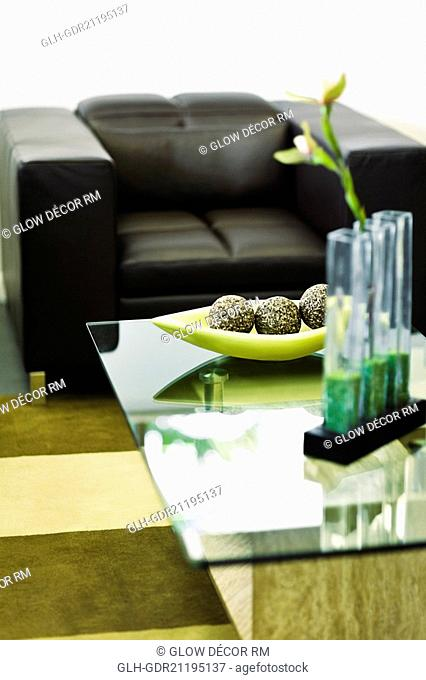 Showpieces on a table with two seater sofa