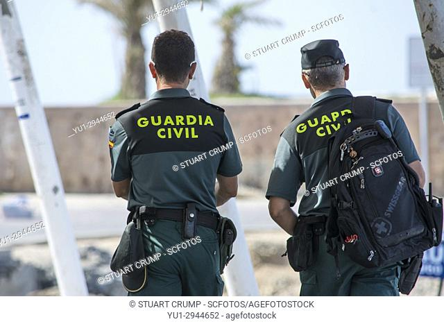 Two Spanish Civil Guard (Guardia Civil) Officers patrol the harbour on the Spanish island of Tabarca