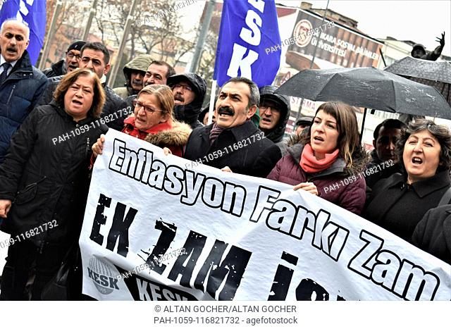 15 January 2019, Turkey, Ankara: Demonstrators chant slogans as members and supporters of the Confederation of Public Employees Trade Unions (KESK) take part in...