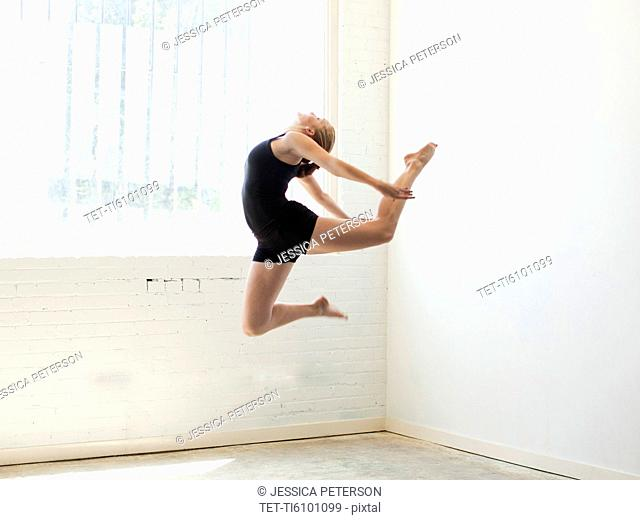 Teenage 16-17 gymnast exercising