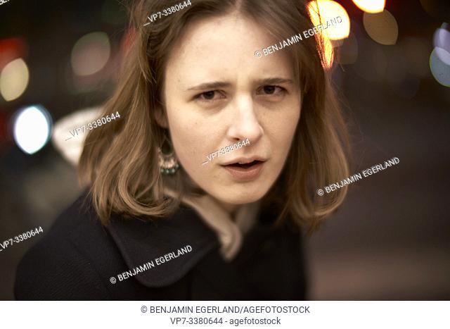 indignant woman at night