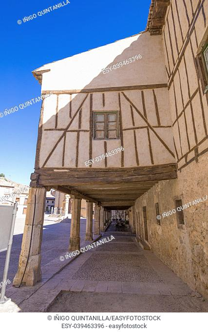 ancient pedestrian medieval arcaded street in Penaranda de Duero village, Burgos, Castile and Leon, Spain, Europe
