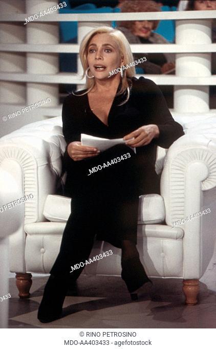 Mara Venier presenting Domenica in. Italian TV presenter and actress Mara Venier (Mara Provoleri) presenting Domenica in. Rome, 1994