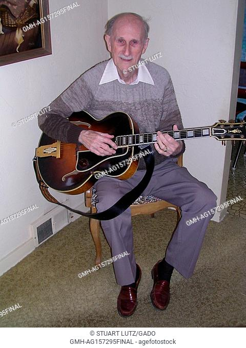 Full length seated portrait of Slim Bryant, who was the last living musician to play with the country music legend Jimmie Rodgers, 2002. ()