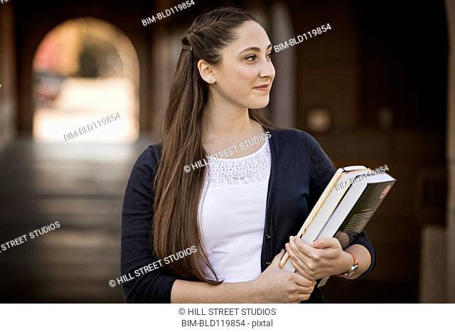 Caucasian student smiling on campus