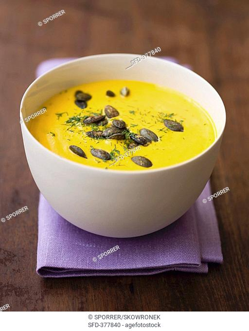 Cream of pumpkin soup with pumpkin seeds and dill