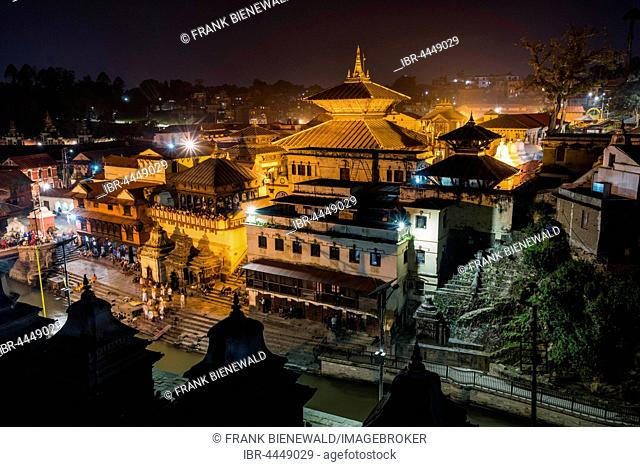 Pashupatinath temple with gaths at banks of Bagmati River, illuminated at night, Kathmandu, Kathmandu District, Nepal