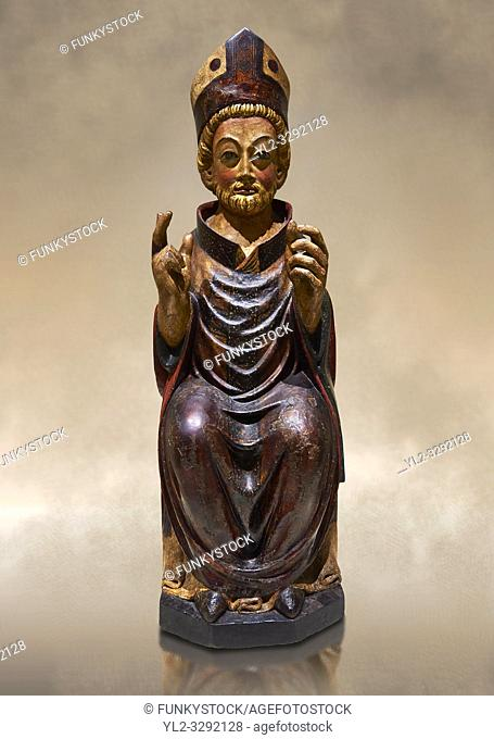 Gothic wood statue of Bishop Saint by the St Bertrand de Cominges Group of artists. Polychrome wood carving with varnished metal-plating