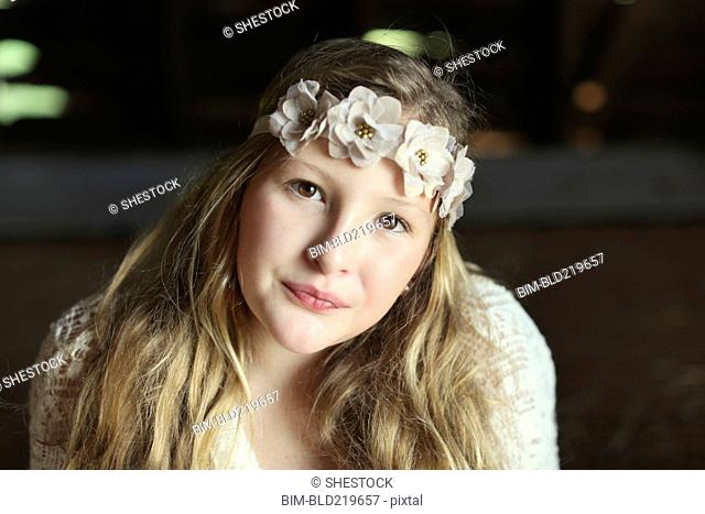 Close up of Caucasian girl wearing flower crown