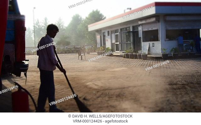 Sweeper in road at Haridwar, Uttarakhand, India