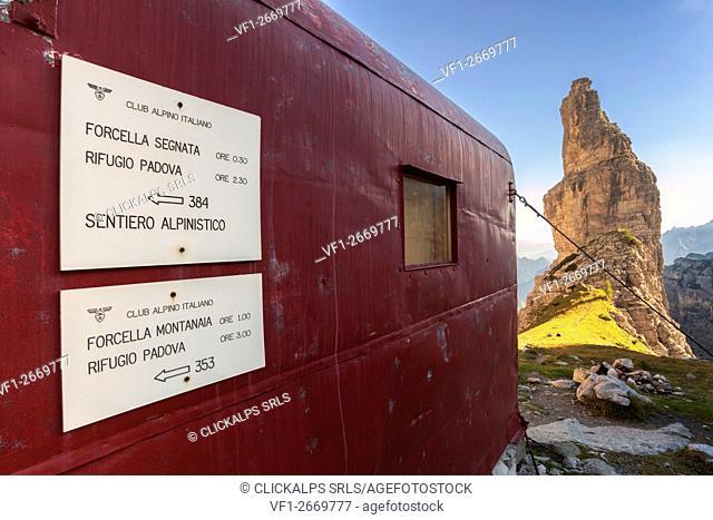 Europe, Italy, Friuli, Pordenone. CAI signs hanging outside the bivouac Giuliano Perugini, in the upper Val Montanaia, Park of the Friulian Dolomites
