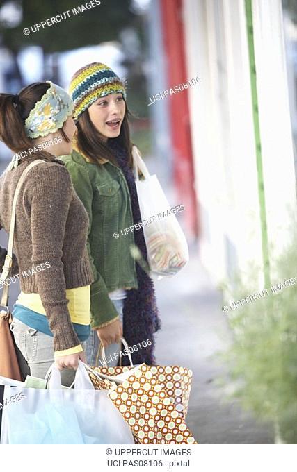Teenage girls window shopping