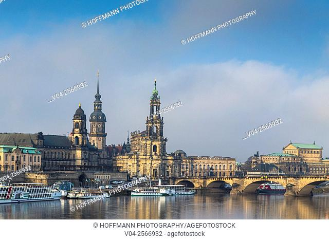 View of the Brühl Terrace with Hausmann Tower, Hofkirche (Catholic Court Chapel) and Semperoper with the river Elbe in the foreground, Dresden, Saxony, Germany