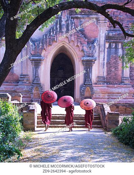 Three young monks at Bagans Sularmuni Temple